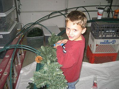 Wyatt helping to attach the garland